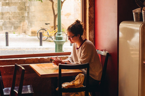 Girl sitting in a cafe
